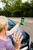 Pedestrian being hit by car while playing Pokemon Go on her smartphone. Ostfildern, Germany - July 17, 2016: A woman playing Pokemon Go on her smartphone is hit Royalty Free Stock Image