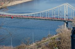 Pedestrian Bridge across Dnipro river in Kyiv, Ukraine. Springtime royalty free stock images
