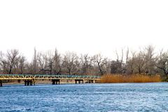 Pedestrian bridge across a large river Royalty Free Stock Images