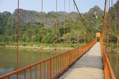 Pedestrian bridge across Nam Song river in tourist oriented town of Vang Vieng, Laos Royalty Free Stock Photography