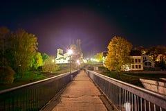 Pedestrian bridge across the river Pskov stock photos