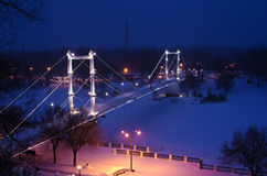 Pedestrian bridge across the river Ural winter evening. Orenburg, Russia. 05/02/2017 Royalty Free Stock Image