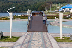 The pedestrian bridge on the embankment. Peshekhodny Bridge on the embankment of the Seaside oceanarium. Russia, Vladivostok Stock Photo