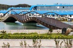 The pedestrian bridge on the embankment. Peshekhodny Bridge on the embankment of the Seaside oceanarium. Russia, Vladivostok Royalty Free Stock Photo