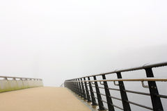 Pedestrian bridge in a heavy fog Royalty Free Stock Images