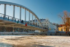 Pedestrian bridge Kaarsild and the view on the embankment of Emajõgi river. During winter in Tartu, Estonia Royalty Free Stock Images