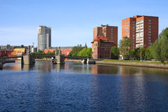 Pedestrian bridge in Kaliningrad. Kaliningrad city, view of the pedestrian bridge and buildings on the banks of the river Pregolya Stock Photos