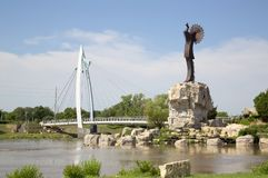 Pedestrian bridge and the keeper of plains Wichita Kansas view. Pedestrian bridge and the keeper of plains in Wichita Kansas, Missouri USA stock photos