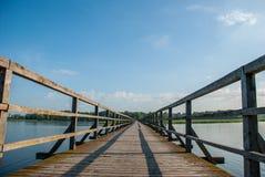 Pedestrian bridge. Long wooden pedestrian bridge over the lake Stock Photo