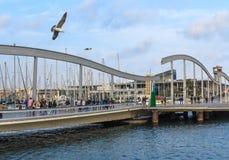Pedestrian bridge in the old port of Barcelona, Spain Royalty Free Stock Photo