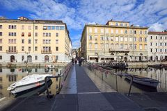 Pedestrian bridge over the Canale Grande in the city quarter Borgo Teresiano. Trieste, Italy. Pedestrian bridge over the Canale Grande in the city quarter Borgo royalty free stock images