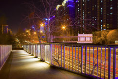 Pedestrian bridge. Over channel by night Royalty Free Stock Image