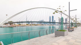 Pedestrian Bridge over the Dubai Water Canal day timelapse, United Arab Emirates stock video footage