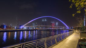 Pedestrian Bridge over the Dubai Water Canal day to night timelapse, United Arab Emirates stock footage
