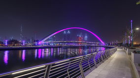 Pedestrian Bridge over the Dubai Water Canal night timelapse hyperlapse, United Arab Emirates stock video