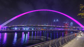 Pedestrian Bridge over the Dubai Water Canal night timelapse, United Arab Emirates stock footage