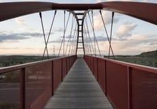 Pedestrian bridge over highway in sunset image Stock Image