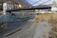 Pedestrian bridge over Isere river Royalty Free Stock Photos