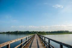 Pedestrian bridge over the lake. Sirvenos in Birzai Royalty Free Stock Photo