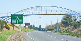 Pedestrian bridge over main road. A modern design of pedestrian bridge to make it ist easy for people to cross main road in the north of Scotland Royalty Free Stock Photos