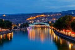 Tbilisi. Bridge of peace at sunset. Stock Photo