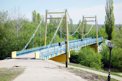Pedestrian bridge over the river Stock Image