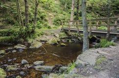Pedestrian bridge in Padley Gorge, Derbyshire, England Royalty Free Stock Photo