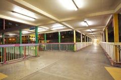 Pedestrian bridge perspective  long corridor of night Royalty Free Stock Photo