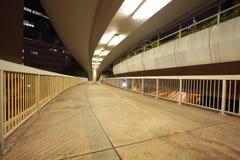 Pedestrian bridge perspective  long corridor of night Royalty Free Stock Images