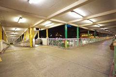 Pedestrian bridge perspective  long corridor of night Royalty Free Stock Photos