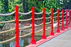 Pedestrian bridge with red ropes and railing Royalty Free Stock Photography