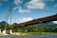 Pedestrian bridge on the river Dunajec, Poland. Stock Photos