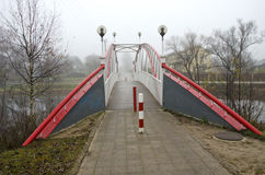 Pedestrian bridge on river and morning mist Royalty Free Stock Images