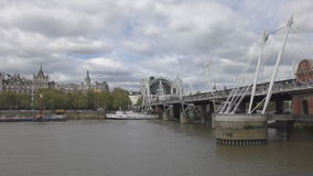Pedestrian bridge on the River Thames. stock video