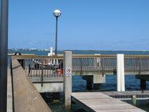 Pedestrian bridge on seacoast. Concrete pedestrian bridge or pier along a sunny seacoast Royalty Free Stock Photo
