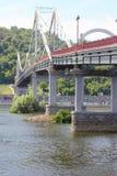 Pedestrian bridge on stone parapets Royalty Free Stock Photos