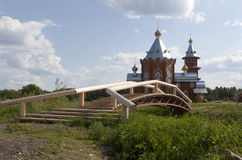 Pedestrian bridge to the Church of the Nativity of the Prophet, Forerunner and Baptist John in the village Zaruchevnya Royalty Free Stock Photography