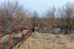 Pedestrian bridge to cross the river. Small pedestrian bridge to cross the river royalty free stock photos