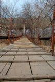 Pedestrian bridge to cross the river. Small pedestrian bridge to cross the river stock images
