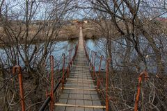 Pedestrian bridge to cross the river. Small pedestrian bridge to cross the river royalty free stock image