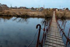 Pedestrian bridge to cross the river. Small pedestrian bridge to cross the river stock photography