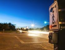 Pedestrian button and traffic. Pedestrian button with narrow depth of field Stock Photos