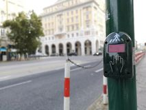 Pedestrian Call Button installed at traffic lights stock images