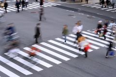 Pedestrian crossing. Aspect of a pedestrian cross with motion blurred aspect of the people Stock Photos