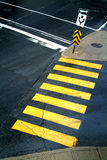 Pedestrian crossing. Yellow pedestrian crossing with road sign royalty free stock photography