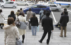 Pedestrian crossing. Image of people waiting to cross the street in a big city Stock Photo