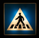 Pedestrian crossing. A lighting pedestrian crossing sign at night Stock Photo