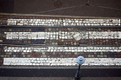 The pedestrian crossing on a cobblestone street Stock Images