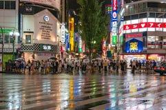 Pedestrian crossing at Kabukicho Ichibangai in Shinjuku. Tokyo, Japan - August 29, 2016: People at pedestrian crossing in Kabukicho Ichibangai with world famous stock photography