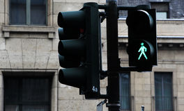 Pedestrian crossing lights and traffic lights, green. Detail of a pedestrian crossing lights and traffic lights, green light, landscape cut Royalty Free Stock Image